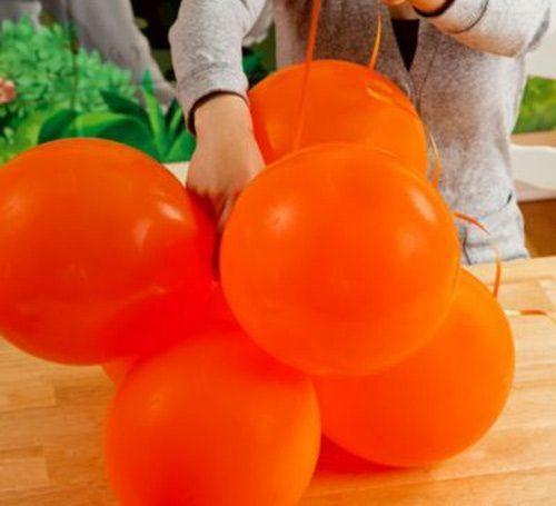 Bong bong tròn màu cam trang trí tiệc